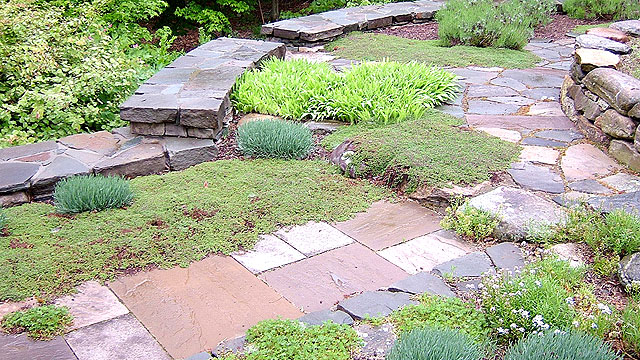 A Combination Oof New England Fieldstone, Quarried Bluestone, And Sandstone Create This Backyard Destination