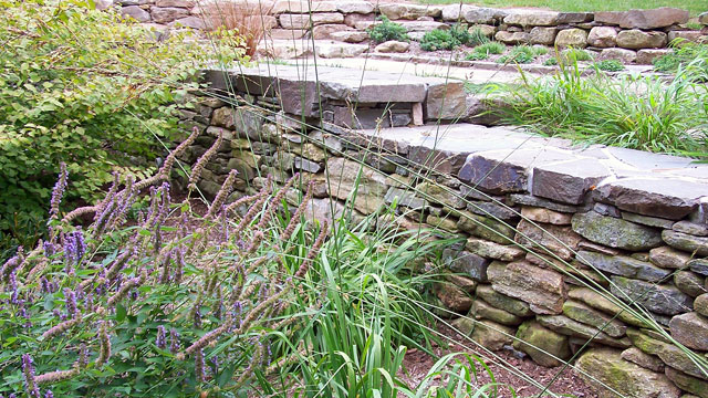New England Fieldstone Retaining Wall With Quarried Bluestone Cap