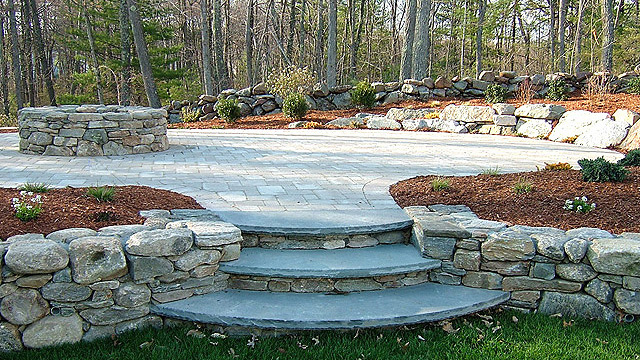 Concrete Paver Patio Surrounded By Natural Stone Walls