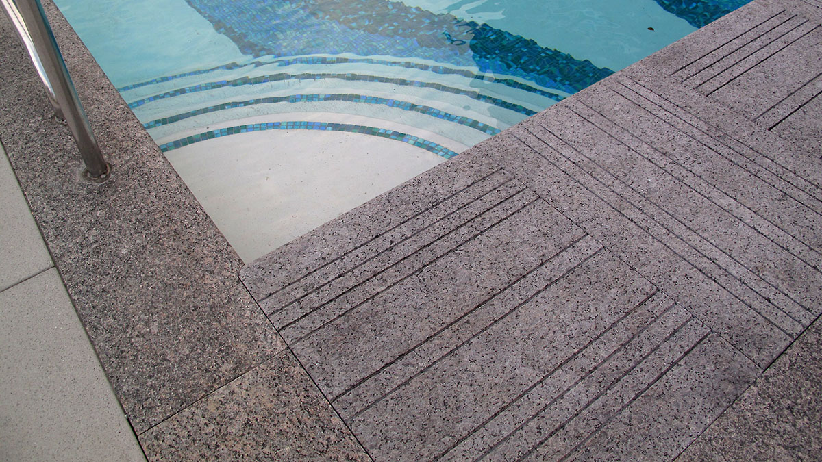 Custom Fabricated, Automatic Pool Cover Vault Stones