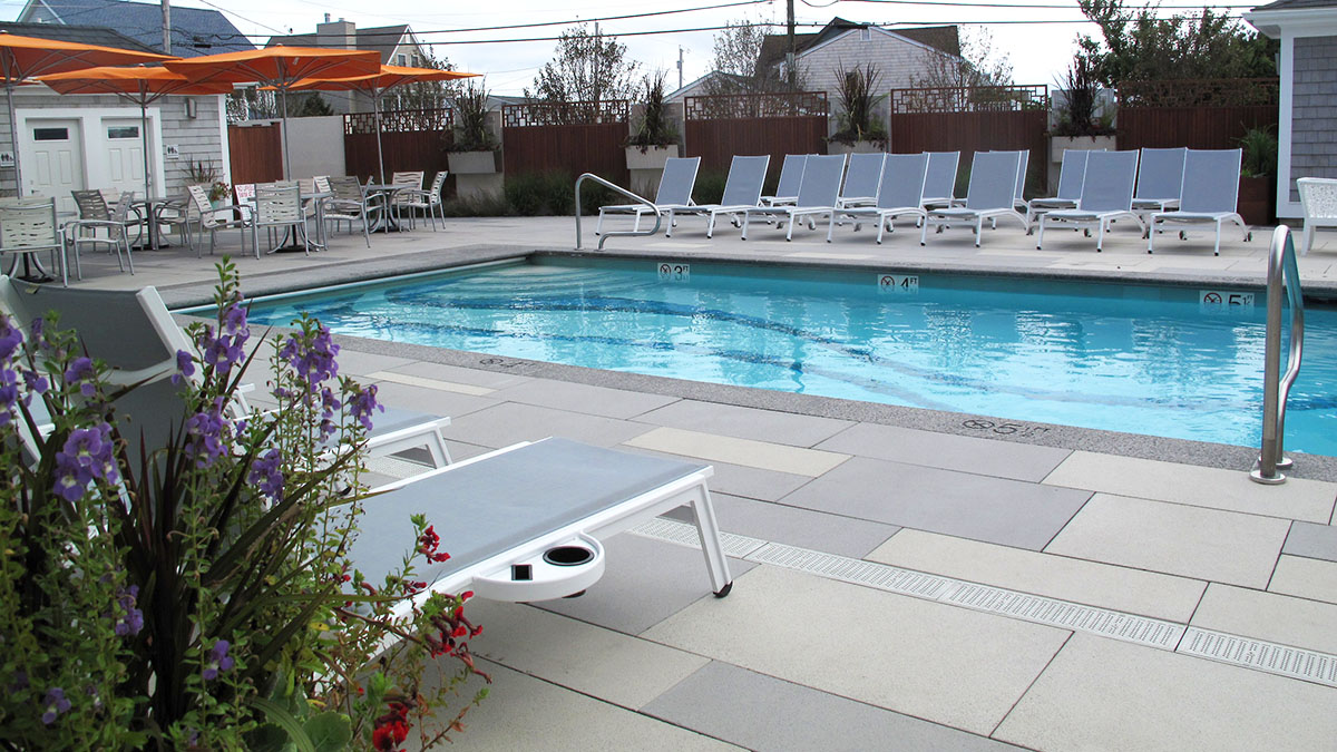 The Pool Patio Is Used For Lounging, Dining, and Swimming