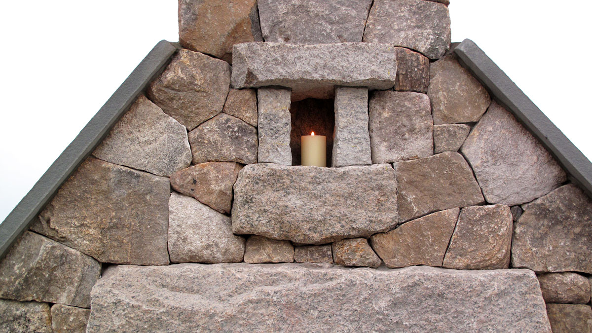 New England Fieldstone and Salvaged Granite Fireplace