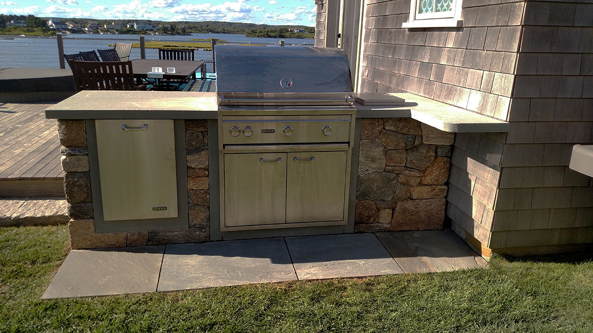 A Small Kitchen Meets the Outdoor Cooking Needs of this Family