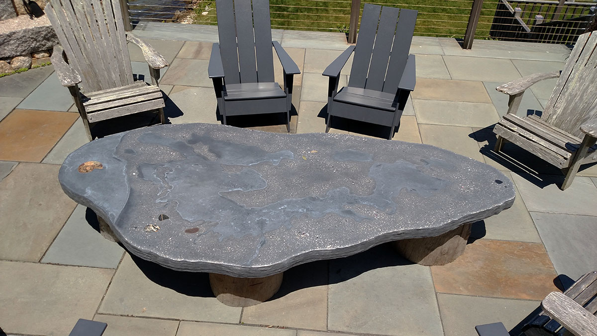 A Custom Built, Decorative Concrete Table Provides the Perfect Place for Resting a Summer Beverage
